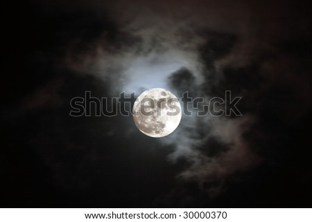 Beautiful full moon in a cloudy night