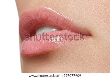 Beautiful full pink lips. Lipstick. Professional make-up. - stock photo