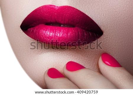 Beautiful full pink lips. Pink lipstick. Gloss lips. Make-up & Cosmetics. Closeup macro photo of pretty natural lips with pink  lipstick  - stock photo