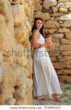 Beautiful fullbody Greek goddess with ancient amphora - stock photo