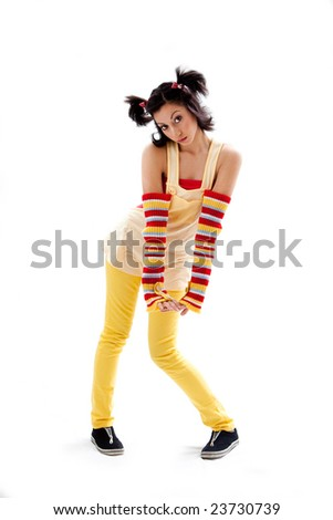 Beautiful fun latina girl with bright colored arm warmers and ponytails with red ribbons in her hair standing with hand down, isolated