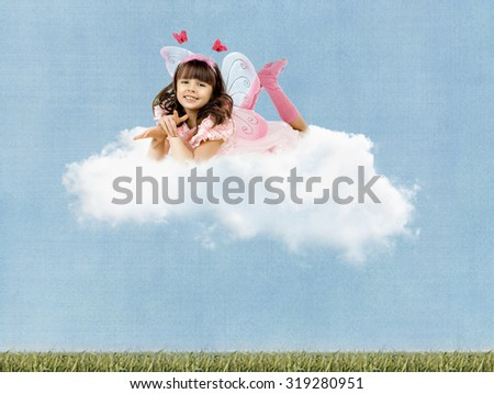 beautiful fun little girl with wings , lie on clouds and  smile on sky background
