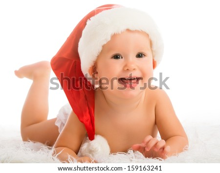 Beautiful funny baby in a Christmas hat isolated on white background - stock photo