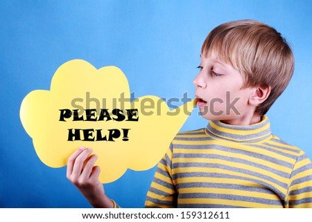 """Beautiful funny blond boy holding a blank yellow message cloud saying """"Please help!"""" over blue background   - stock photo"""