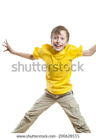 Beautiful funny child in yellow t-shirt jumping in excitement and laughing over white background