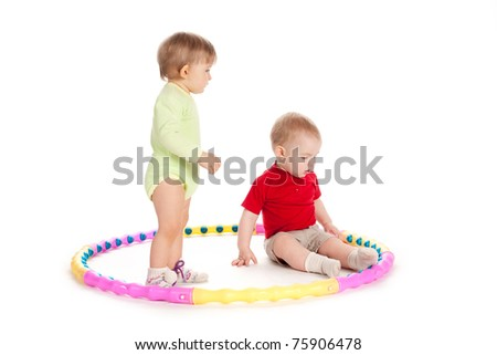 beautiful funny children playing with hoop - stock photo