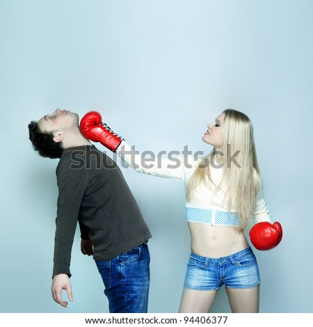 Beautiful Funny couple expressive fighting - stock photo