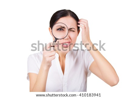 Beautiful funny girl searching with magnifier. Isolated