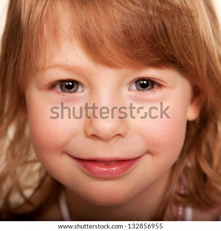 Beautiful funny red haired little girl.