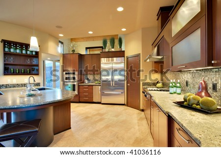 Beautiful furnished kitchen in luxury home - stock photo