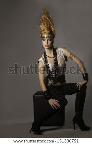 Beautiful futuristic tribal woman with upright bronze hair  - stock photo