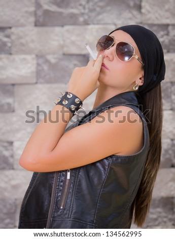 Beautiful gang woman smoking. - stock photo