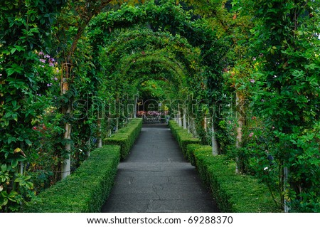 Beautiful garden arches and path inside the historic butchart gardens (over 100 years in bloom), vancouver island, british columbia, canada - stock photo