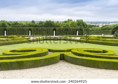 Beautiful garden in a Famous palace Versailles. The Palace Versailles was a royal chateau. It was added to the UNESCO list of World Heritage Sites. Paris, France. - stock photo
