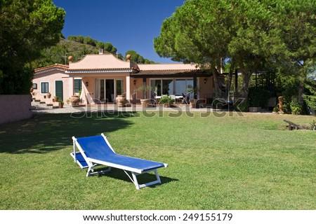 beautiful garden of a villa - stock photo