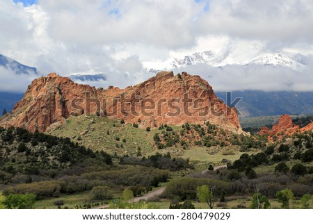 Beautiful Garden of the Gods and Pike's Peak covered with clouds - stock photo
