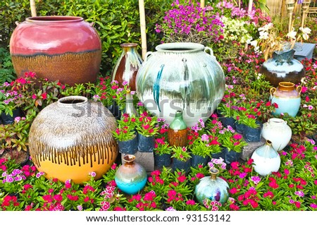 Beautiful garden park decorate with colorful jar - stock photo
