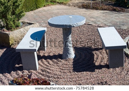 Beautiful garden patio seating corner made from stone granite - stock photo
