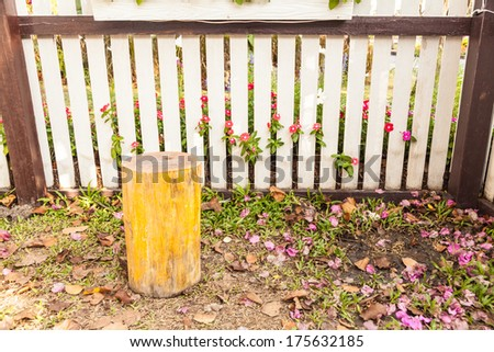 beautiful garden  with flowers and white picket fence - stock photo