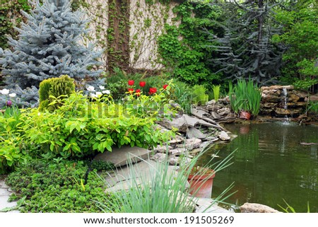 Beautiful garden with pond - stock photo