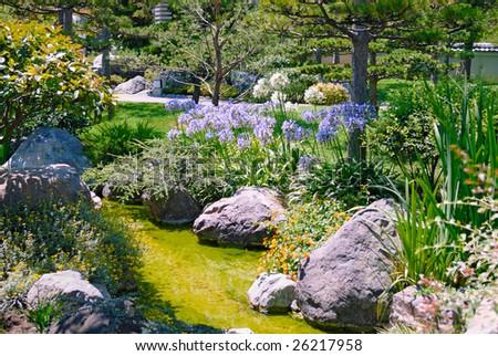 Beautiful garden with stream - stock photo
