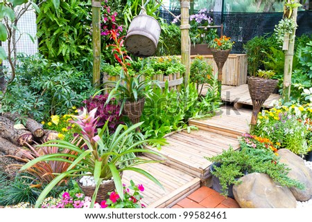 beautiful garden with wooden stair - home decoration - stock photo