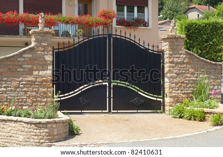 Beautiful gate, entrance to a front yard - stock photo
