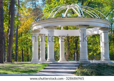 beautiful gazebo in autumn park - stock photo
