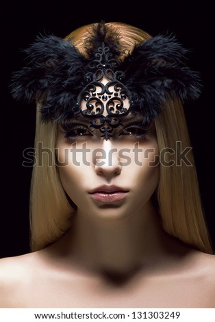 Beautiful Genuine Woman in Styled Black Mask with Feathers. Aristocratic Face - stock photo