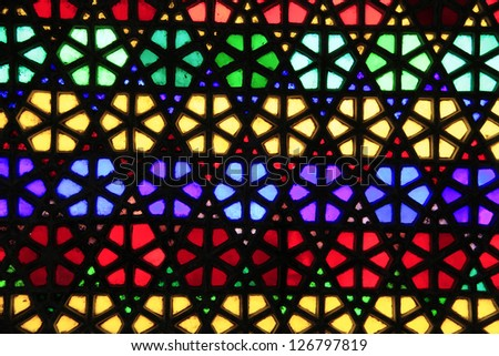 Beautiful geometric pattern of colorful stained glass window - stock photo