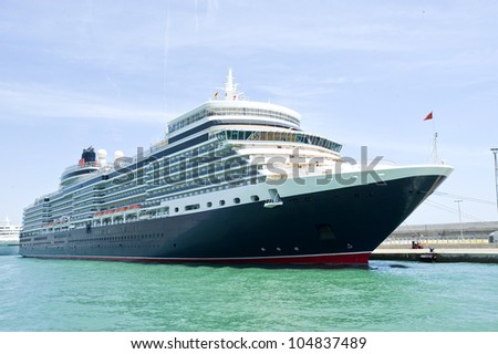 beautiful giant cruise ship on stay at harbor - stock photo