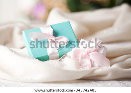 Beautiful gift box and diamond ring. Concept of wedding, marriage, wealth and luxurious lifestyle. (soft focus) - stock photo