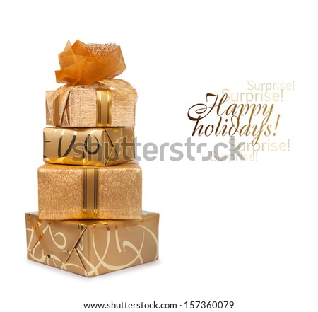 Beautiful gift box in gold paper with a silk rose isolated on a white background - stock photo
