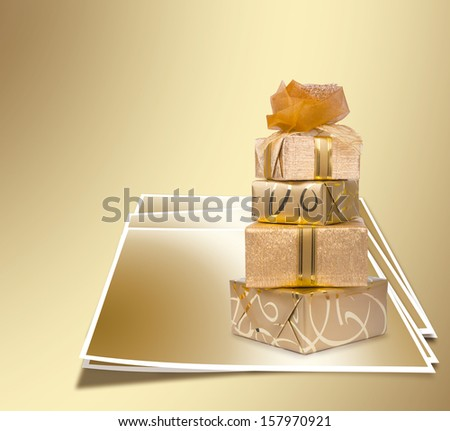 Beautiful gift box in gold paper with a silk rose on gold abstract background - stock photo