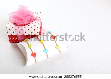 Beautiful gift box on light background. Valentine Day concept - stock photo