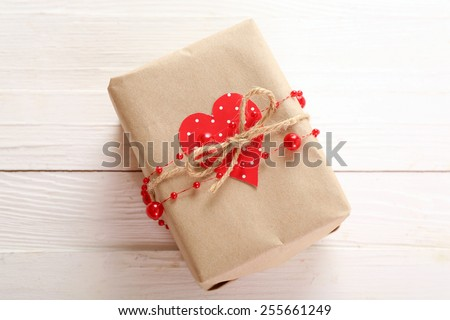 Beautiful gift box on wooden table. Valentine Day concept - stock photo