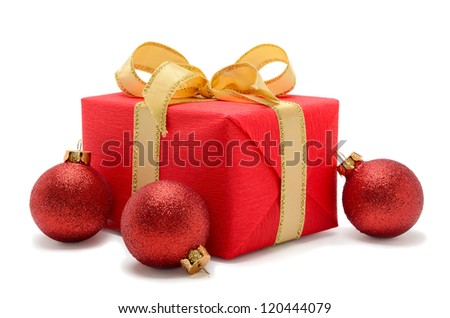Beautiful gift box with christmas balls all in red color isolated on white background - stock photo