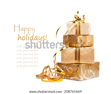 Beautiful  Gift boxes in gold wrapping paper isolated on a white background - stock photo