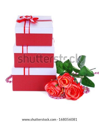 Beautiful gift boxes with flowers isolated on white