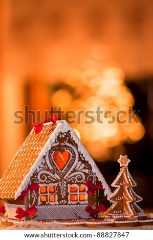 beautiful gingerbread house decorated with frosting - stock photo
