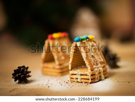 beautiful gingerbread house on wooden background with Christmas decorations - stock photo
