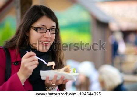 Beautiful girl about to eat - stock photo