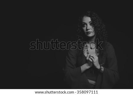 Beautiful girl actress in a beautiful dress on a black - stock photo
