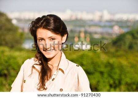 Beautiful girl against city of Kiev. - stock photo