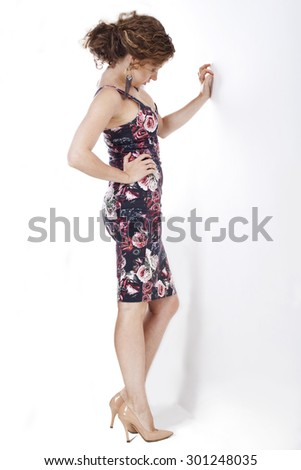 Beautiful girl against the wall. - stock photo
