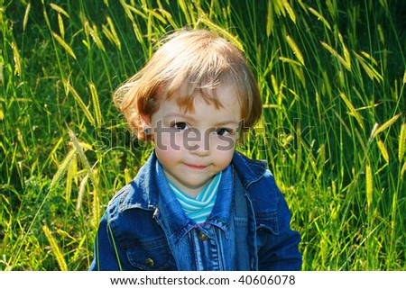 beautiful girl amongst green herb - stock photo