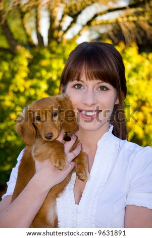 Beautiful girl and her adorable dachshund puppy.