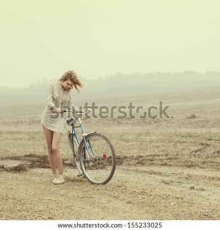 beautiful girl and hipster bike - stock photo