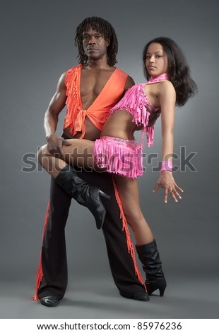 Beautiful girl and lad in latin dance suit - stock photo