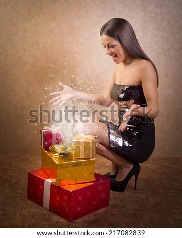 beautiful girl and magical Christmas present box  - stock photo